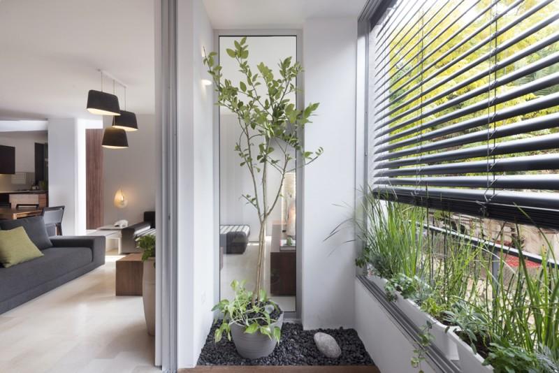 יצירת חללים וחללי ביניים בדירה שתוצאתם נוחות ושימוש מלא השראה ביומיום, אדריכל גל טבת, צילום: גדעון לוין
